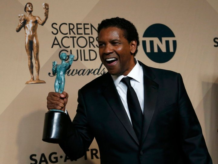 """Denzel Washington poses with the award he won for Outstanding Performance by a Male Actor in a Leading Role for """"Fences"""" backstage at the 23rd Screen Actors Guild Awards in Los Angeles"""
